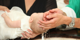 web-baptism-baby-priest-hands-c2a9-antonio-gravante-shutterstock