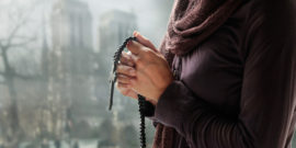 web3-woman-hands-praying-rosary-shutterstock