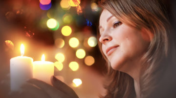 WEB3-WOMAN-CHRISTMAS-CANDLES-SMILE-LIGHTS-shutterstock_211836604.jpg w=1200